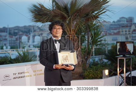 Bong Joon-ho poses  during the Award Winners photocall at the 72 Cannes Film Festival in Cannes, France on May 25, 2019.