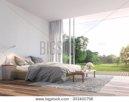 Modern Bedroom 3d Render.the Rooms Have Wooden Floors ,decorate With Gray Fabric Bed,there Are Large