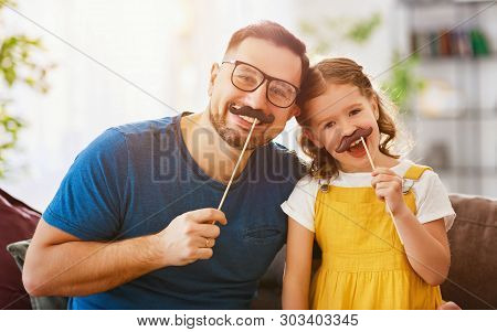 Father's Day. Happy Funny Family Daughter And Dad With Mustache .