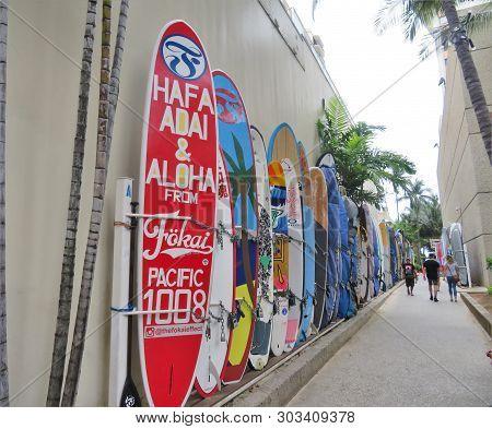 Honolulu, Hawaii -4/29/2018 - Surfboards Stored In An Alley Way On Waikiki Beach, Honolulu, Hawaii
