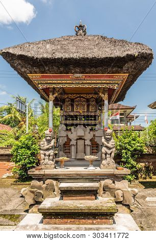 Dusun Ambengan, Bali, Indonesia - February 25, 2019: Decorated Gray Stone Memorial Pillar At Clan Co