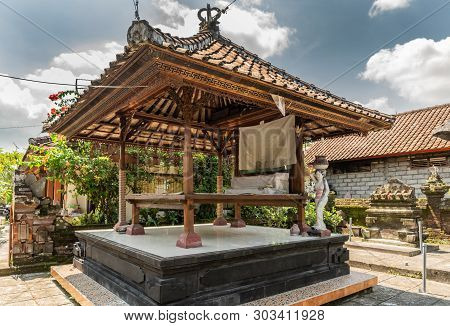 Dusun Ambengan, Bali, Indonesia - February 25, 2019: Clan Compound. Open Air Bed Under Red Roof In G