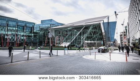 People Walking In Front Of The Gais Energy Theater In The Docks Of Dublin