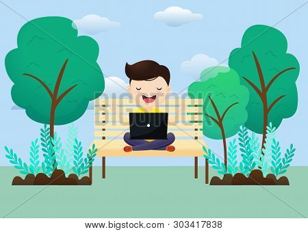 Young Man Relaxes After Working On A Laptop Sitting In A Lotus Pose Outdoors. Freelancer Meditates S