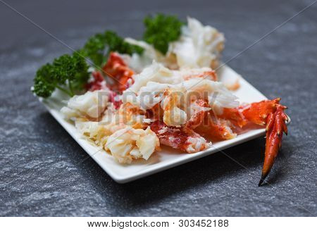 Crab Meat On White Plate With Spices For Cooked Seafood / Red Crab Legs
