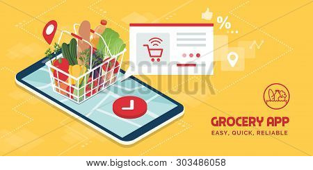 Grocery Delivery At Home And Smartphone App: Full Shopping Basket With Fresh Vegetables, Food And Be