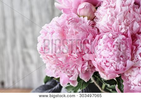 Bouquet Of Pink Peony Flowers Against A White Rustic Wood Background  With Copy Space For Your Text.