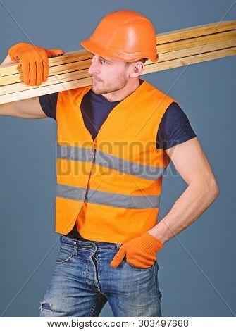 Hardy Labourer Concept. Carpenter, Woodworker, Labourer, Builder On Busy Face Carries Wooden Beams O
