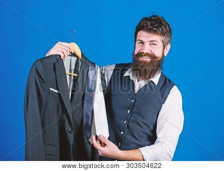 Shop Assistant Or Personal Stylist Service. Matching Necktie Outfit. Man Bearded Hipster Hold Neckti