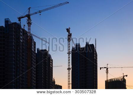 Construction site with many cranes at sunset,Fuzhou,China