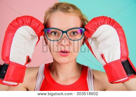 Strong mentally and physically. Smart and strong. Woman boxing gloves adjust eyeglasses. Win with strength or intellect. Strong intellect victory pledge. Know how defend myself. Confident her power poster
