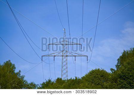 Electricity pylon of a power line through Bavaria poster