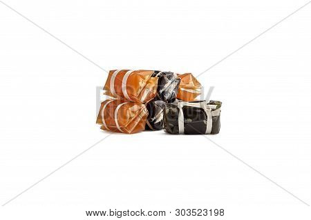 Stack Of Thai Caramel Or Kalamare With Sesame Isolated