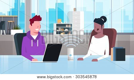 Mix Race People Sitting At Workplace Desk Man Woman Using Intelligent Smart Speaker With Voice Recog
