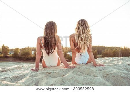 Two Girlfriends Woman Long Hair, View From Back, Girls Sisters, Sit Sunbathe Summer Beach White Sand