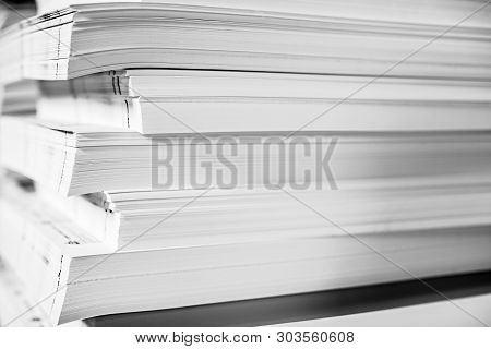 A Huge Pile Of Paper In The Printing House. Printing Industry Texture Background