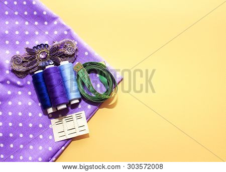 Sewing Accessories And Fabric On A Yellow Background. Concept For Needlework, Stiching, Embroidery.