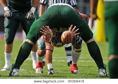 INNSBRUCK, AUSTRIA - JULY 10: OL Ben Gregson (#68 Australia) snaps the ball at the Football World Championship on July 10, 2011 in Innsbruck, Austria. Mexico wins 65:0 against Australia.
