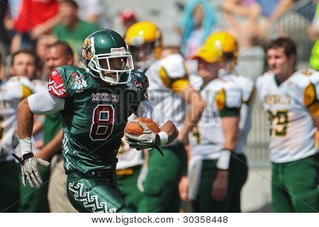 INNSBRUCK, AUSTRIA - JULY 10: WR Josh  Alfonso (#8 Mexico) runs with the ball at the Football World Championship on July 10, 2011 in Innsbruck, Austria. Mexico wins 65:0 against Australia.