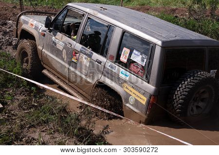Moscow, Russia - May 25, 2019: Isuzu Trooper Suv Overcomes Obstacles In The Mud. Off-road Driving.
