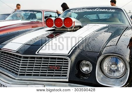 Moscow, Russia - May 25, 2019: Black Chevrolet Camaro Z28 1977 350 With White Stripes On The Hood An