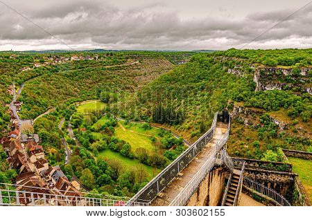 Panoramic View Of The Village Of Rocamadour The Alzou River Valley And The Causse Calcareous Mountai