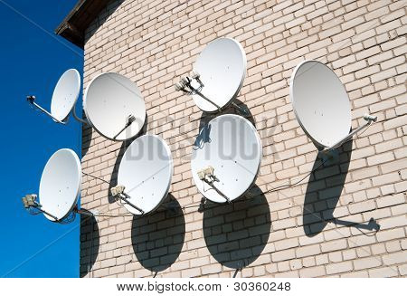 Seven Satellite Dish On The White Wall