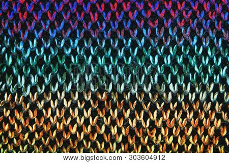 Loose Knitwear Fabric Texture with wool fibers. Repeating Machine Knitting Texture of warm Sweater. Bright colored Knitted Background. poster