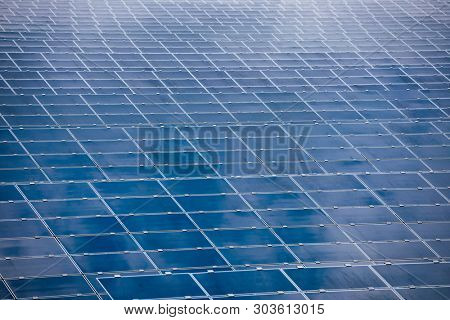 Array of Solar panels at Photovoltaic power station or Solar farm absorb sunlight to generate electricity