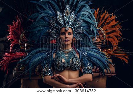 Three Beautiful Young Womans In Traditional Brasilian Carnaval Costumes Are Posing For Photographer