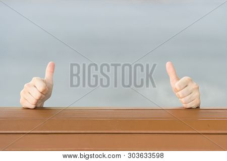 If You Like It Thumbs Ups. Human Hands Giving Thumbs Ups Sign On Grey Background. Extending Hands Wi