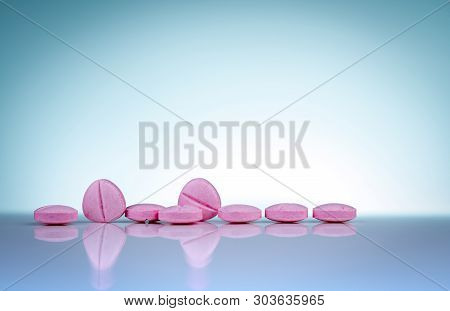 Pink Tablets Pills With Shadow On Gradient Background. Pharmaceutical Industry. Pharmacy Products. V