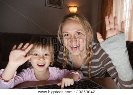 Mother And Daughter Talking In The Internet