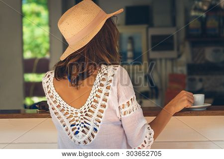 Woman Drinking Espresso Coffee At Beach Bar In Vacation. Woman Relaxing In Bar In Vacation. Vacation