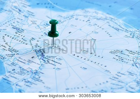 Office Button Pointing To The Destination On The Map Antarctica, South Pole. Antarctica, South Pole