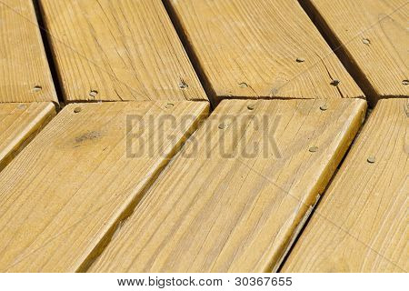 Angled Exterior Stained Wooden Deck Planks
