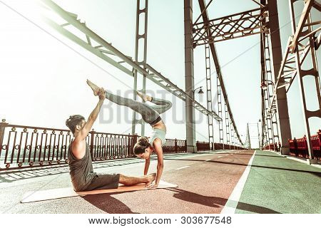 Dark-haired Female Yogi Standing In A Handstand Pose