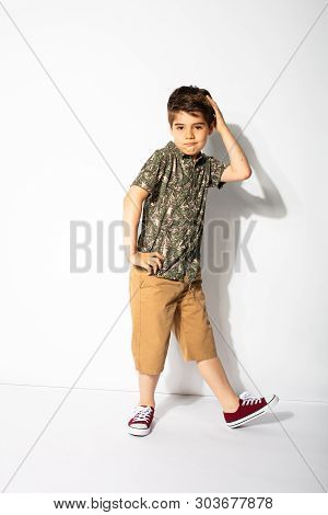 Young Boy Posing On White Background