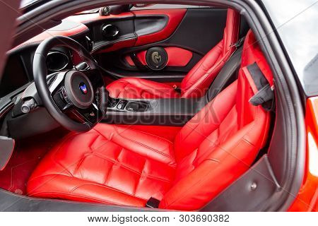Novosibirsk, Russia - 05.29.2019: Interior Of A Sports Car Marussia B1 Of Red Color With Elegant Lea