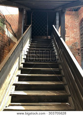 Gray Wooden Staircase With Railing Going Up
