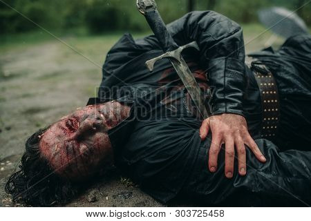 A Young Man In The Image Of A Murdered Medieval Knight Lying On The Ground And With Worms Crawling O
