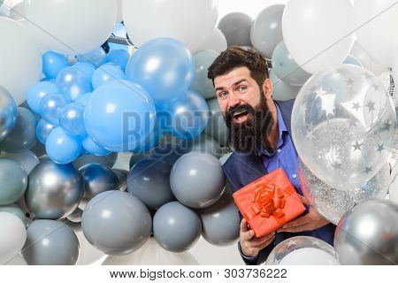 poster of People, joy, birthday, celebration. Festive event or birthday party. Happy birthday guy holds helium balloons and gift box. Handsome man celebrating something. Bearded man in suit holds birthday gift.