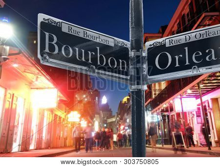 Bourbon Street Sign And Street View In New Orleans French Quarter At Night