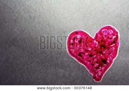 Backlit Pink Textured Heart On Gray Background