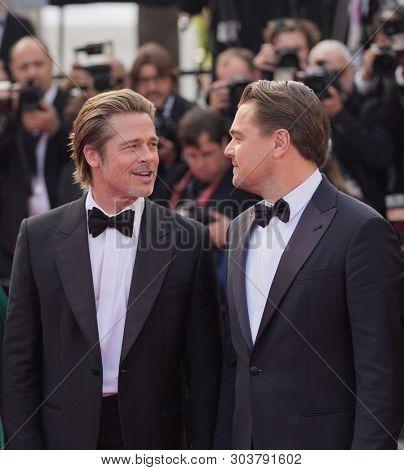 Leonardo DiCaprio and Brad Pitt attend the screening of