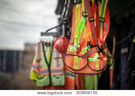 Personal Protective Equipments For Sale On A Shop: Harness, Reflective Vests, Yellow Jackets, Constr