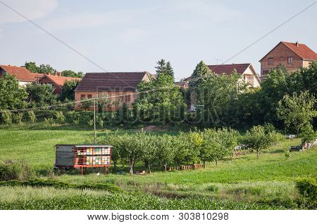 Beehives In A Field In A Typical Rural Landscape Of Europe, Taken In Indjija, Voivodina, Serbia, Wit