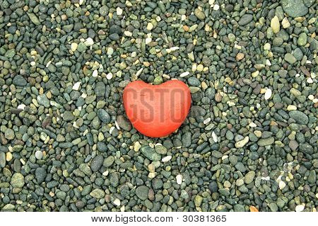 red heart in the middle with rock background