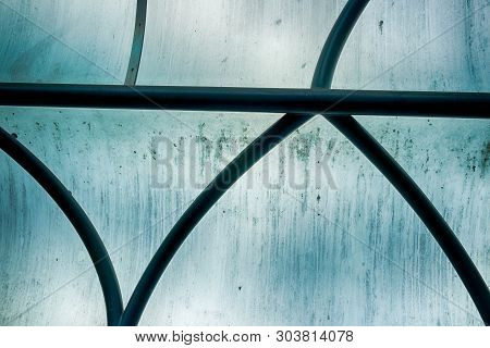 Abstract Building Window Glass With Iron Bars In Daylight