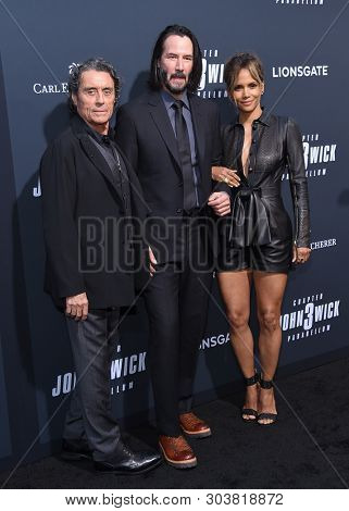 LOS ANGELES - MAY 15:  Ian McShane, Keanu Reeves and Halle Berry arrives for the John Wick: Chapter 3 - Parabellum' L.A. Special Screening on May 15, 2019 in Hollywood, CA